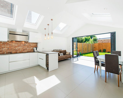 This Is An Example Of A Contemporary U Shaped Open Plan Kitchen In London  With