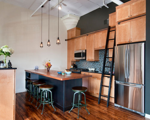 Example Of An Urban Single Wall Kitchen Design In Philadelphia With  Stainless Steel Appliances,