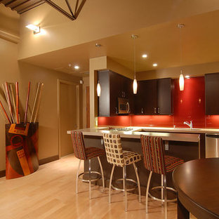 Small modern open concept kitchen ideas - Open concept kitchen - small modern galley linoleum floor open concept kitchen idea in Phoenix with an undermount sink, dark wood cabinets, stainless steel countertops, red backsplash, glass sheet backsplash and stainless steel appliances