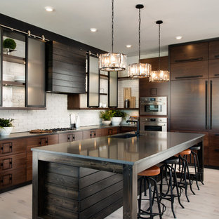 Inspiration for a large industrial l-shaped eat-in kitchen in Other with an undermount sink, flat-panel cabinets, dark wood cabinets, white splashback, brick splashback, panelled appliances, light hardwood floors, with island, beige floor and soapstone benchtops.
