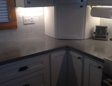 Log Cabin Grey Concrete Countertops White Cabinets