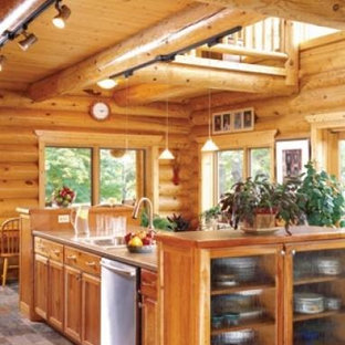 Photo of a country kitchen in Other with light wood cabinets, limestone benchtops and with island.