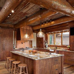 Inspiration för ett mycket stort rustikt l-kök, med skåp i mellenmörkt trä, granitbänkskiva, mellanmörkt trägolv, en köksö, en rustik diskho, fönster som stänkskydd och integrerade vitvaror