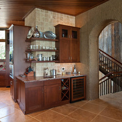Loggy Bayou Birdhouse - Bentwood cabinetry is displayed beautifully in home built by Terry M. Elston, Builder known as the Loggy Bayou Birdhouse. Cabinetry design by Kori Shurley. Photography by Mary Ann Elston