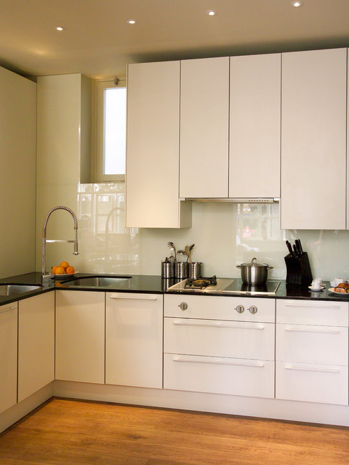 small contemporary enclosed kitchen photos example of a small trendy u shaped medium tone - Glass Sheet Kitchen Design