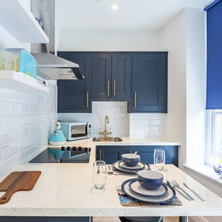 Contemporary kitchen remodeling - Kitchen - contemporary u-shaped kitchen idea in Los Angeles with a drop-in sink, shaker cabinets, blue cabinets, subway tile backsplash, stainless steel appliances, a peninsula and white countertops