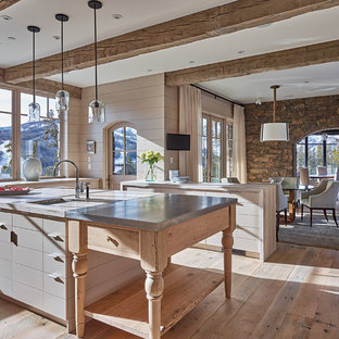 Large farmhouse u-shaped kitchen/diner in Other with a belfast sink, flat-panel cabinets, grey cabinets, zinc worktops, medium hardwood flooring and an island.
