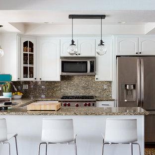 Photo of a mid-sized midcentury u-shaped eat-in kitchen in Los Angeles with white cabinets, granite benchtops, multi-coloured splashback, stone slab splashback, stainless steel appliances, dark hardwood floors and a peninsula.