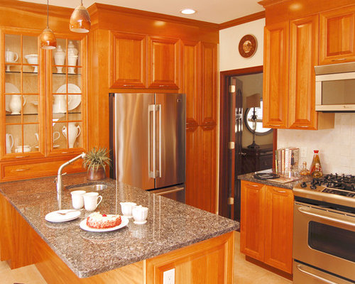 traditional kitchen idea in new york with raised panel cabinets and stainless steel appliances - Light Hardwood Kitchen Decoration