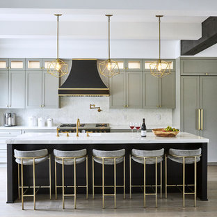 Kitchen - mid-sized contemporary kitchen idea in New York with shaker cabinets, marble countertops, white backsplash, marble backsplash, an island and white countertops