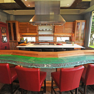 This is an example of an asian kitchen in Orlando with glass benchtops and green benchtop.