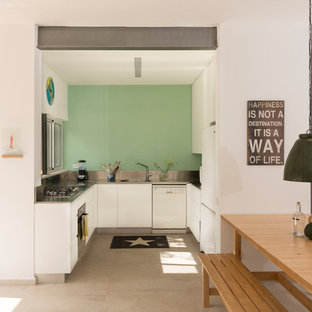 Design ideas for a small contemporary u-shaped kitchen in Tel Aviv with an integrated sink, white cabinets, stainless steel benchtops, metallic splashback, white appliances, ceramic floors and metal splashback.