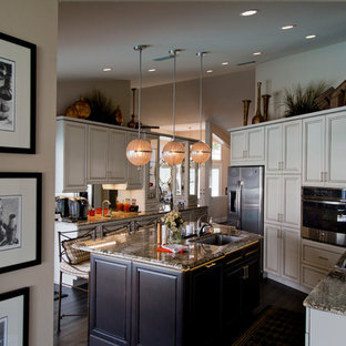 Large traditional l-shaped separate kitchen in Miami with an undermount sink, louvered cabinets, white cabinets, granite benchtops, mirror splashback, stainless steel appliances, dark hardwood floors, with island and brown floor.
