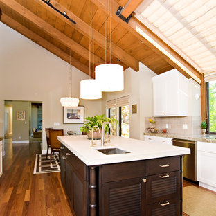 Design ideas for a large contemporary u-shaped separate kitchen in San Francisco with an undermount sink, louvered cabinets, dark wood cabinets, quartzite benchtops, grey splashback, porcelain splashback, stainless steel appliances and medium hardwood floors.
