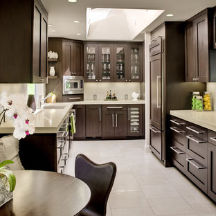 Transitional eat-in kitchen appliance - Example of a transitional u-shaped eat-in kitchen design in San Francisco with glass-front cabinets, dark wood cabinets, quartz countertops, paneled appliances and beige backsplash