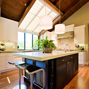 Large contemporary u-shaped separate kitchen in San Francisco with louvered cabinets, dark wood cabinets, an undermount sink, granite benchtops, grey splashback, subway tile splashback, stainless steel appliances and medium hardwood floors.