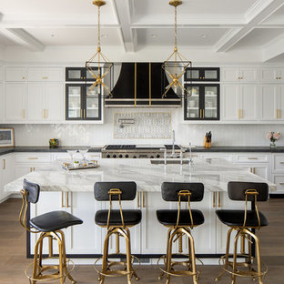 Transitional eat-in kitchen designs - Inspiration for a transitional u-shaped medium tone