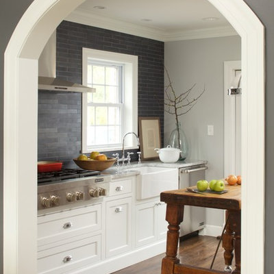 Kitchen - transitional kitchen idea in New York with a farmhouse sink, beaded inset cabinets, white cabinets, gray backsplash and slate backsplash
