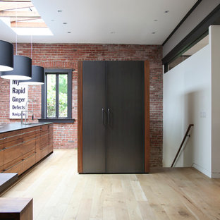 Kitchen - modern kitchen idea in San Francisco with shaker cabinets, medium tone wood cabinets and paneled appliances
