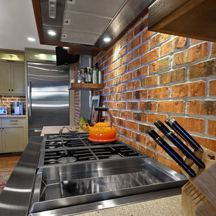 Example of a mid-sized transitional l-shaped eat-in kitchen design in Charleston with stainless steel appliances, an undermount sink, recessed-panel cabinets, gray cabinets, quartz countertops and an island