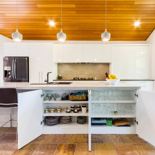 Design ideas for a large contemporary galley eat-in kitchen in Melbourne with a drop-in sink, flat-panel cabinets, white cabinets, quartz benchtops, stainless steel appliances, porcelain floors, with island, brown floor, grey benchtop and brown splashback.