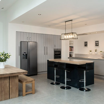 Inspiration for a large contemporary l-shaped eat-in kitchen remodel in Dublin with an undermount sink, flat-panel cabinets, gray cabinets, stainless steel appliances and a peninsula