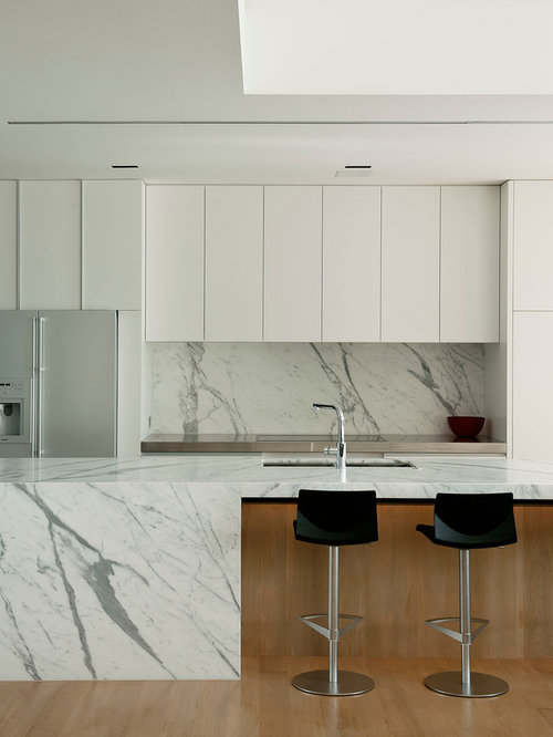 inspiration for a contemporary galley open concept kitchen remodel in auckland with white backsplash stone - Marble Kitchen Design