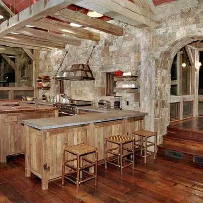 Kitchen - rustic kitchen idea in Denver with wood countertops, stainless steel appliances and stone tile backsplash