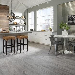 Large contemporary eat-in kitchen ideas - Eat-in kitchen - large contemporary u-shaped dark wood floor and gray floor eat-in kitchen idea in Other with flat-panel cabinets, white cabinets, granite countertops and a peninsula