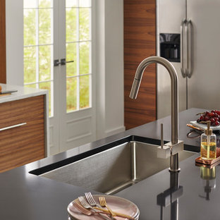 Kitchen pictures - Inspiration for a kitchen remodel in Chicago with a single-bowl sink and black countertops