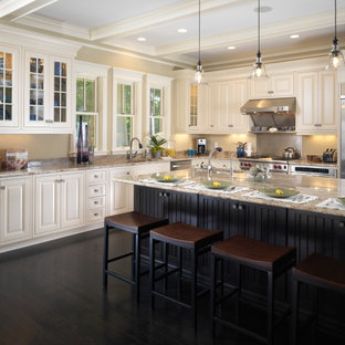Large transitional eat-in kitchen designs - Eat-in kitchen - large transitional l-shaped dark wood floor and brown floor eat-in kitchen idea in Tampa with a drop-in sink, raised-panel cabinets, white cabinets, granite countertops, brown backsplash, granite backsplash, stainless steel appliances, an island and brown countertops