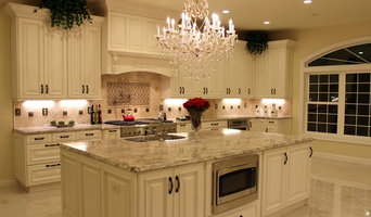 Luxurious Kitchen w/Antique White Cabinetry & Sienna Bordeaux Granite Countertop