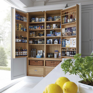 This is an example of a kitchen pantry in Manchester with shaker cabinets and grey cabinets.