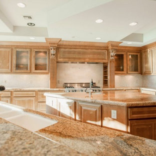 Photo of a large u-shaped open plan kitchen in Las Vegas with a triple-bowl sink, medium wood cabinets, stainless steel appliances, marble floors and with island.