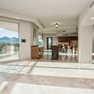 Large u-shaped open plan kitchen in Las Vegas with a triple-bowl sink, medium wood cabinets, stainless steel appliances, marble floors and with island.