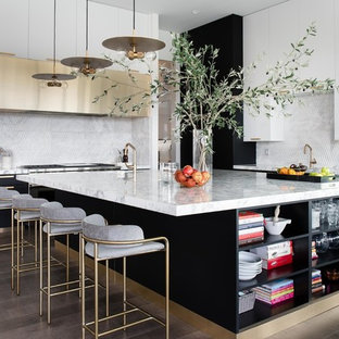 Large contemporary kitchen ideas - Large trendy dark wood floor and brown floor kitchen photo in Las Vegas with flat-panel cabinets, an island, white cabinets, marble countertops, white backsplash and white countertops