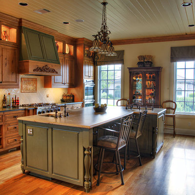 Inspiration for a timeless kitchen remodel in Austin with an undermount sink, raised-panel cabinets, medium tone wood cabinets and beige backsplash
