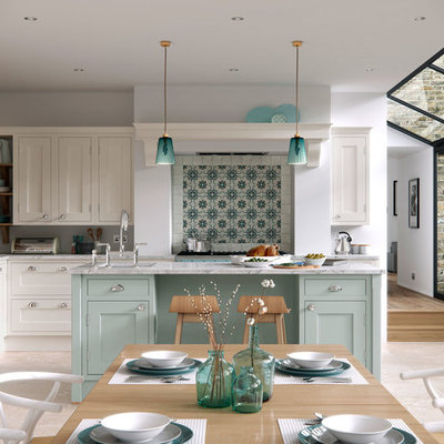 Inspiration for a large farmhouse l-shaped light wood floor open concept kitchen remodel in Manchester with shaker cabinets, marble countertops, an island and blue cabinets