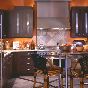 Inspiration for a mid-sized industrial l-shaped open plan kitchen in Other with an undermount sink, flat-panel cabinets, black cabinets, quartz benchtops, grey splashback, slate splashback, stainless steel appliances, slate floors and with island.