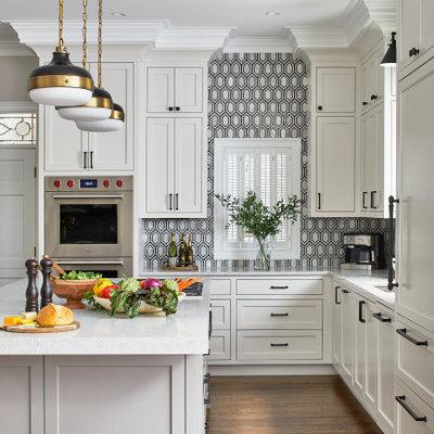 Kitchen - large modern l-shaped dark wood floor kitchen idea in Atlanta with a single-bowl sink, white cabinets, quartz countertops, black backsplash, mosaic tile backsplash, paneled appliances, an island, gray countertops and beaded inset cabinets