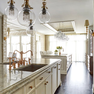 This is an example of an expansive traditional eat-in kitchen in Chicago with an undermount sink, recessed-panel cabinets, white cabinets, quartzite benchtops, grey splashback, marble splashback, coloured appliances, dark hardwood floors, multiple islands, brown floor and beige benchtop.