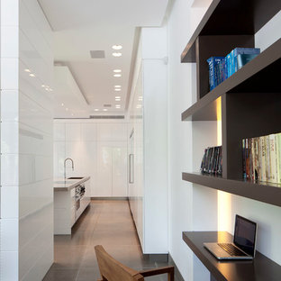 Large modern eat-in kitchen designs - Inspiration for a large modern l-shaped limestone floor eat-in kitchen remodel in Other with a drop-in sink, white cabinets, concrete countertops, stainless steel appliances and an island