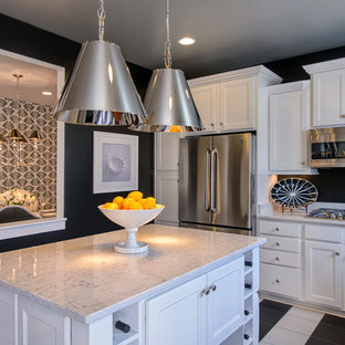 Example of a trendy kitchen design in DC Metro with recessed-panel cabinets, white cabinets and stainless steel appliances