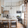 A Compact Kitchen Climbs Up for More Storage