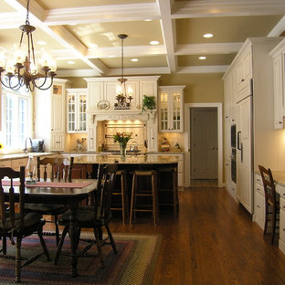 Design ideas for a traditional l-shaped eat-in kitchen in DC Metro with panelled appliances.