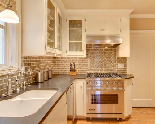 Traditional Kitchen Idea In Seattle With A Double Bowl Sink Gl Front Cabinets