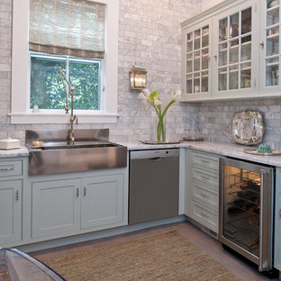 Mid-sized traditional enclosed kitchen inspiration - Enclosed kitchen - mid-sized traditional l-shaped light wood floor enclosed kitchen idea in New York with a farmhouse sink, beaded inset cabinets, blue cabinets, marble countertops, stainless steel appliances, gray backsplash, no island and marble backsplash