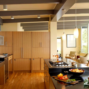 Inspiration for a large 1960s galley medium tone wood floor open concept kitchen remodel in Seattle with flat-panel cabinets, light wood cabinets, granite countertops, a single-bowl sink, stainless steel appliances and an island