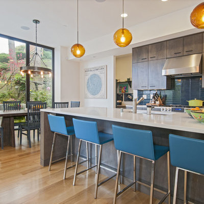 Trendy eat-in kitchen photo in Seattle with an undermount sink, flat-panel cabinets, dark wood cabinets and blue backsplash