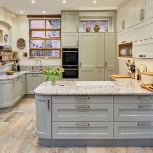 Photo of a medium sized classic kitchen in Berkshire with grey cabinets, granite worktops, multi-coloured splashback, porcelain flooring, multi-coloured floors, multicoloured worktops, a submerged sink, shaker cabinets and a breakfast bar.